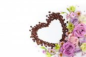 Festive concept for Valentine day or Mothers day with flowers and coffee beans in shape of heart on poster