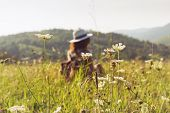 Traveler Girl Relaxing In Fields. Young Girl Traveler Relaxing In Nature. Traveler With Backpack In  poster