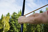 picture of longbow  - Man is ready to shoot from sport bow - JPG
