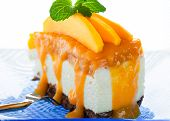 stock photo of tort  - A piece of cheese cake with fresh mango and mango sauce on whitebackground - JPG