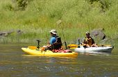 image of kayak  - two men fishing and kayaking in a kayak on John Day River in Central Oregon - JPG