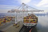 image of maryland  - Container ship at berth having container removed by post Panamax cranes - JPG