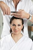 picture of hair cutting  - portrait of young woman having her hair being cut - JPG