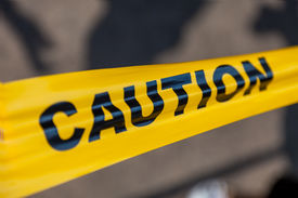 stock photo of safety barrier  - the Caution yellow tapeon the site - JPG
