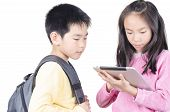 stock photo of bagpack  - Smart children using touch pad computer on white background - JPG