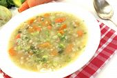 image of porridge  - fresh Barley porridge with carrots on a light background - JPG