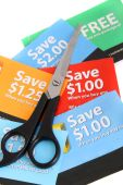 picture of thrift store  - Cutting coupons in different colors and price ranges from free to a few dollars  - JPG