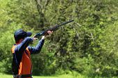 stock photo of ammo  - Young man skeet shooting or trap shooting - JPG