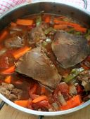 picture of dutch oven  - Vertical view of a pot of lamb - JPG