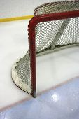 picture of ice hockey goal  - Goal post and net in a hockey arena - JPG