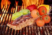 stock photo of brisket  - Grilled Pork Brisket on Cast Iron Grate in fire background XXXL - JPG