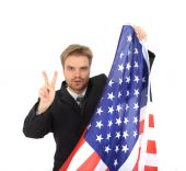 stock photo of imbecile  - businessman and USA flag isolated on the white background - JPG