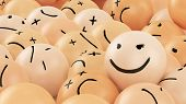 stock photo of angry smiley  - One positive smiley ball in the heap of angry balls - JPG