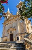 image of gozo  - St Margaret parish in Sannat between the trees - JPG