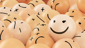 foto of angry smiley  - One positive smiley ball in the heap of angry balls - JPG