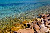 stock photo of dinosaur-eggs  - Rocky coast in Greece with nice water  - JPG