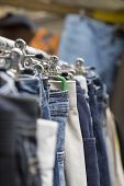 pic of thrift store  - clothes on a rack on a flea market.