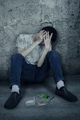 stock photo of hallucinations  - Drugs user hallucinating and sitting on the corner - JPG