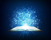 picture of bible story  - Old open book with magic light and falling stars - JPG