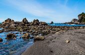 stock photo of klamath  - Wilson Creek beach Klamath California big rocks formation in water blue sky - JPG