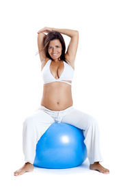 image of pregnancy exercises  - Beautiful pregnant woman making exercises on a fitness ball - JPG