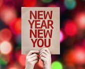 picture of happy new year 2014  - New Year New You card with colorful background with defocused lights - JPG