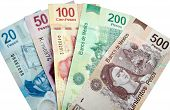 stock photo of pesos  - Mexican Pesos bank notes isolated on white background - JPG