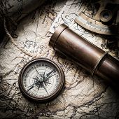 stock photo of spyglass  - vintage  still life with compass - JPG