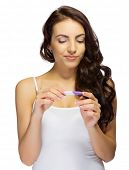 pic of pregnancy  - Young girl with pregnancy test isolated - JPG