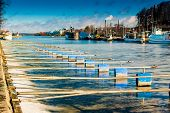 pic of pier a lake  - The spring starts to melt the ice on the lake Nasijarvi at Tampere Finland - JPG
