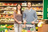 picture of grocery store  - Young couple shopping in a grocery store - JPG