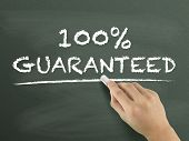 picture of 100 percent  - 100 percent guaranteed words written by hand on blackboard - JPG