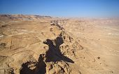 stock photo of zealots  - View on Judean desert and roman fortification from fortress Masada Israel - JPG