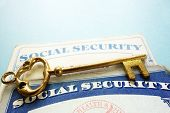 pic of social-security  - Social Security cards and old gold key  - JPG