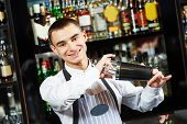 image of bartender  - Portrait of young barman worker at bartender desk in restaurant bar  - JPG