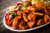 foto of boil  - Grilled meat with boiled potatoes and vegetables - JPG
