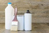 image of paint pot  - bottle aerosol paint pot and brush on wooden table - JPG