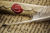 picture of feathers  - Feather pen and scroll on old manuscript - JPG