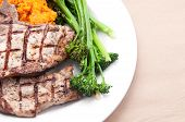 foto of pork chop  - farm raised heritage pork sirloin chops with fresh vegetabes - JPG
