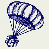 stock photo of parachute  - Present and parachute falling from the sky - JPG
