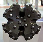 image of drill bit  - brand new oil rig drill bit detail - JPG