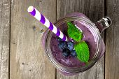 picture of masonic  - Blueberry smoothie with mint in mason jar mug with straw - JPG