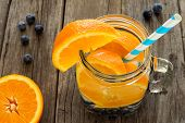 image of mason  - Detox water with oranges and blueberries in a mason jar with straw - JPG