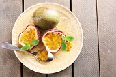 stock photo of passion fruit  - Passion fruits on wooden background - JPG
