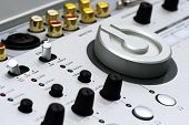 stock photo of controller  - Detail of silver DJ mixer controller with buttons - JPG