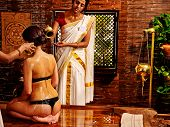 image of ayurveda  - Young woman having ayurveda spa treatment - JPG