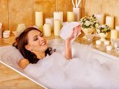 foto of bubble bath  - Woman relaxing at water in bubble bath - JPG