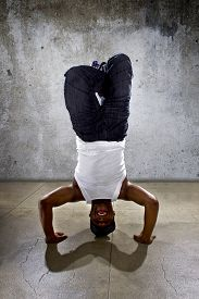 picture of inverted  - Inverted black breakdancer doing a headstand or handstand or urban yoga - JPG