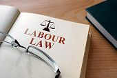 Notepad with words labour law. poster