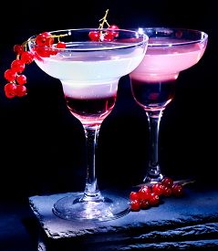 stock photo of cocktail menu  - Group pomegranate cocktail decoration red currant  branch  on black background - JPG